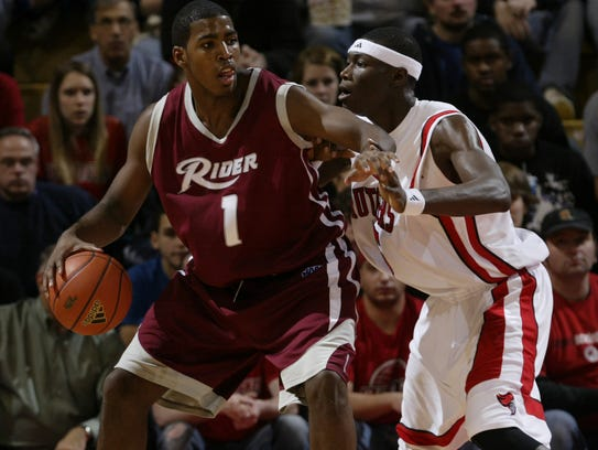 Jason Thompson, left, dribbles against Rutgers in 2007.
