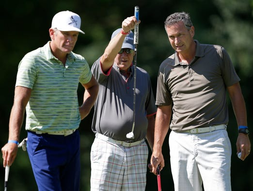 Mark Skogen, left, Bob Antolec, center, and John Gingrich, right, line up a putt during the U.S. Venture Open charity golf event at Northshore Golf Club on August 13, 2014, in Menasha, Wis. Wm.Glasheen/Post-Crescent Media