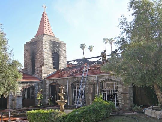 Firefighters put out the remains of a fire at the historic Community Church in Palm Springs, Wednesday, September 18th, 2013.