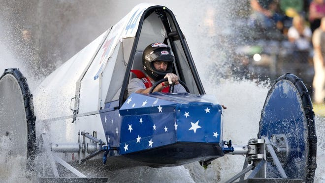 """Driver Tyler Johns drives his swamp buggy """"Top Gun"""" during the Budweiser Spring Classic at the Florida Sports Park Saturday, April 9, 2016 in East Naples. Johns is recovering in a Miami-area hospital after losing part of his left arm in an airboat accident."""