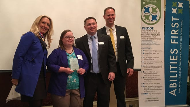 Participant of the Year Jessica Doering, second from left, is show with Abilities First Chief Advancement Officer Melissa McCoy, left to right, Abilities First CEO Dr. Jeffery Fox and Abilities First Board of Directors Vice President Daniel Stafford.