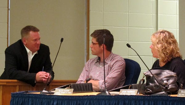 Mayor Eric Bookmeyer and Council members Alex Kuhn and Jean Marinos talk during a 2012 meeting.