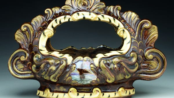 This 14-inch wide faience bowl made by the Galle factory sold for $968. His cameo glass brings much higher prices.