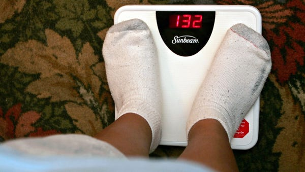 Weight loss will help with high cholesterol and other problems.