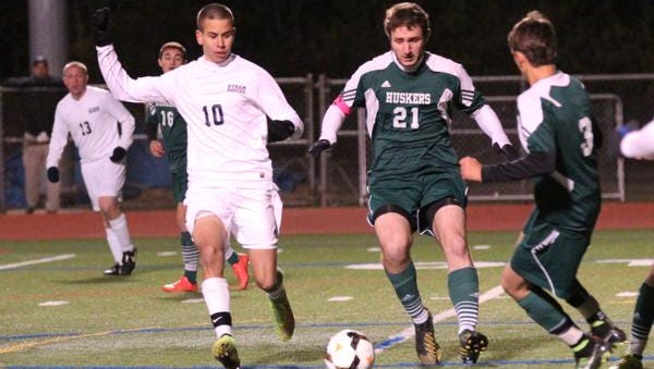 Byram Hills' Cole Tannor, left, battles for the ball with Yorktown's David Merta and Joseph Landicino during the Class A sectional final on Sunday, Nov. 2, 2014, at Arlington High School.