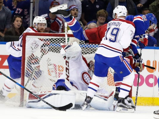 Montreal Canadiens' Andrei Markov (79) watches as New York Rangers' Rick Nash (61) trips over goalie Carey Price (31) during the first period of an NHL hockey game of Game 4 of an NHL hockey first-round playoff series Tuesday, April 18, 2017, in New York. (AP Photo/Frank Franklin II)