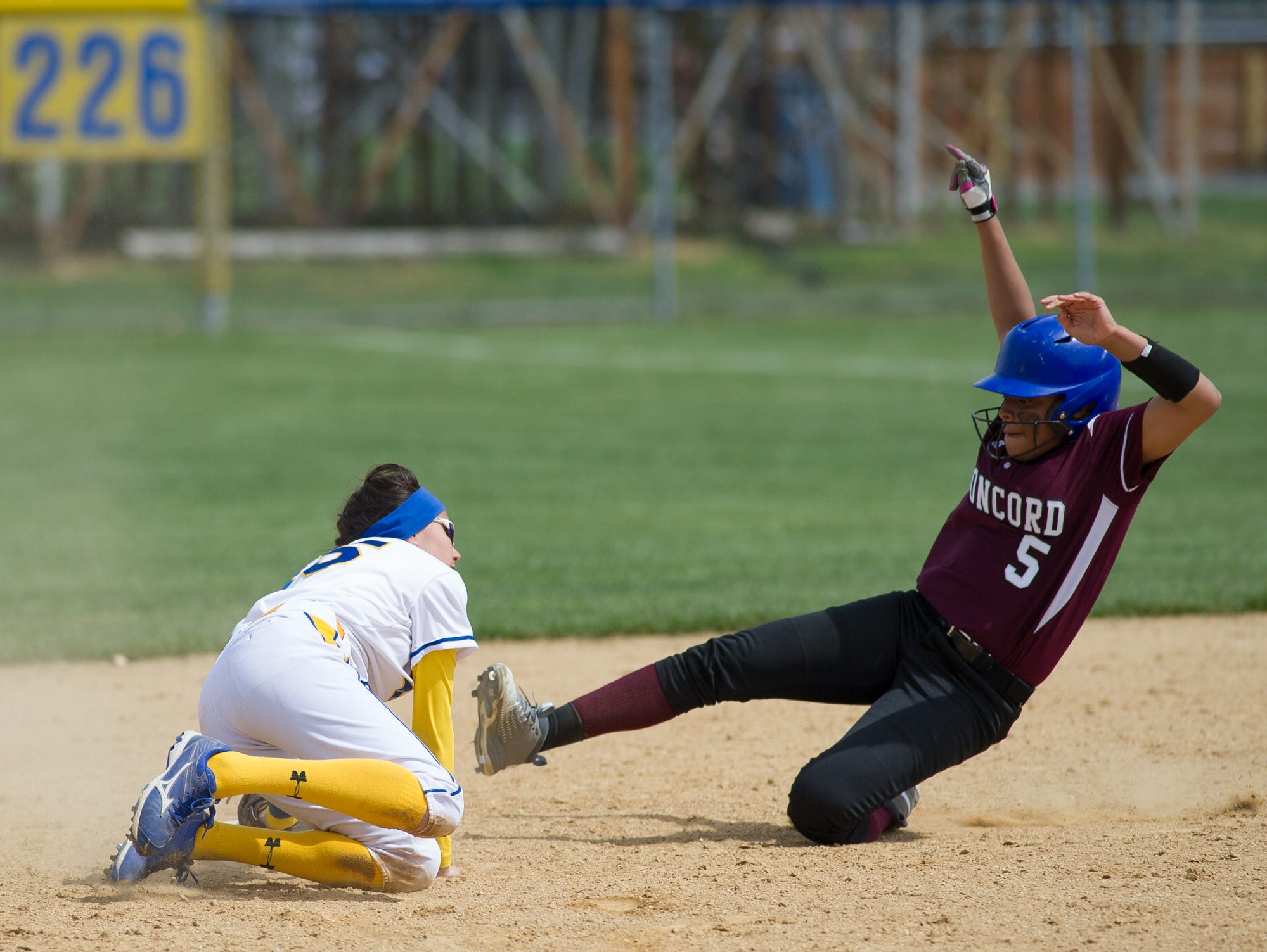 Caesar Rodney's Courtney Malin (15) tags Concord's Makaila Gordy (5) out at second base.