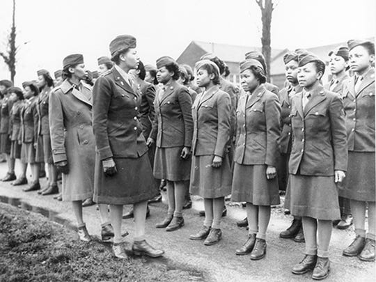 In this historical photo, Major Charity Adams, Commander, and Captain Abbie Campbell, Executive Officer, inspects the 6888th Central Postal Directory Battalion in England in February 1945.