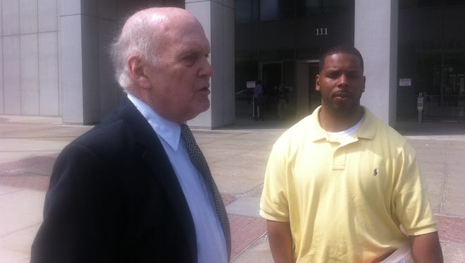 Jamar Smythe, right, and his lawyer, Herman Kaufman, outside the Westchester County Courthouse on Tuesday after drug charges against Smythe were dismissed because of tainted testimony by two Yonkers detectives at his 2012 trial.