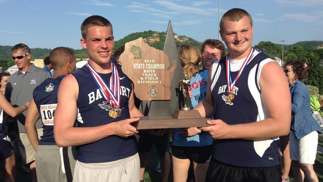 Bay Port senior Zach Lorbeck, left, and junior Cole Van Lanen pose with the WIAA Division 1 boys state track and field championship trophy June 6 in La Crosse.