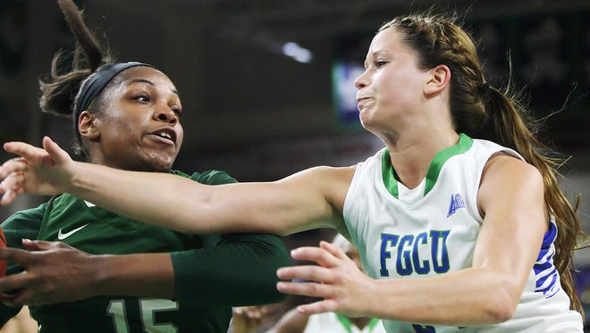 FGCU's Taylor Gradinjan battles Jacksonville's Kayla Gordon for a rebound in FGCU's 62-42 win in the Atlantic Sun Conference tournament semifinals March 11, 2015, in Alico Arena.