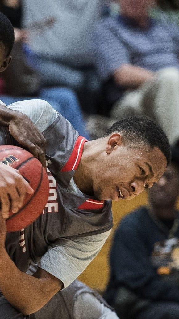 Wade Hampton's D'Cameron Range, right, fights for possession of the ball with Woodmont's Reggie Young during the Generals' 77-53 win Tuesday night. Young scored 15 points to lead Woodmont. Range scored 10 points for Wade Hampton.
