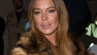 Lindsay Lohan attends the Gareth Pugh show during London Fashion Week at Victoria & Albert Museum on Feb. 21, 2015 in London, England.
