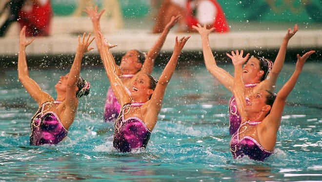 Members of the United States' synchronized swimming team splash as they perform their gold-medal-winning routine Friday at the 1996 Summer Olympics in Atlanta, Georgia. The American team won the gold.
