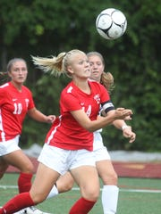 Somers' Melina Couzis controls the ball on her way
