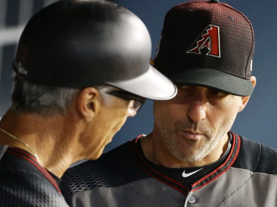 Diamondbacks manager Torey Louvllo (right) is getting out-managed through two games in the NLDS.