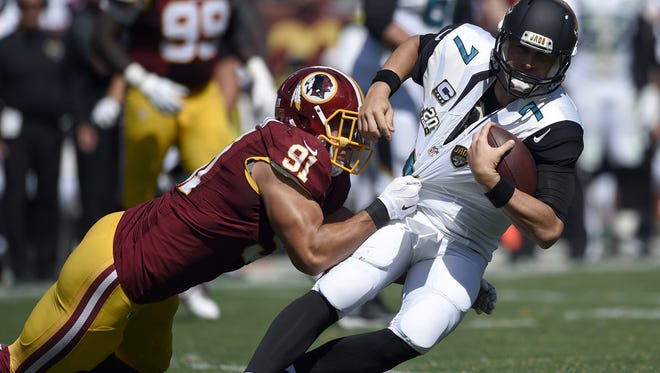 Washington  outside linebacker Ryan Kerrigan pulls down  Jaguars quarterback Chad Henne during Sunday?s game in Landover, Md. Washington quarterback Robert Griffin III was taken out of the game with a dislocated ankle. Washington Redskins outside linebacker Ryan Kerrigan (91) pulls down Jacksonville Jaguars quarterback Chad Henne (7) during the first half of an NFL football game Sunday, Sept. 14, 2014, in Landover, Md.
