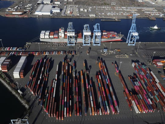 FILE - In this March 5, 2019, file photo, cargo containers are staged near cranes at the Port of Tacoma, in Tacoma, Wash. Most economists were already worried that the odds of a recession are rising, and most of the worries stem from the U.S.-China trade war. (AP Photo/Ted S. Warren)