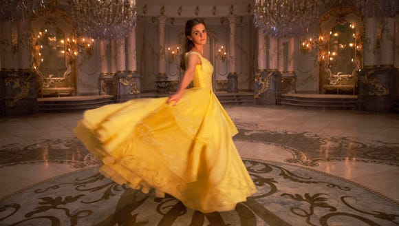 Emma Watson as Belle in the iconic yellow dress.