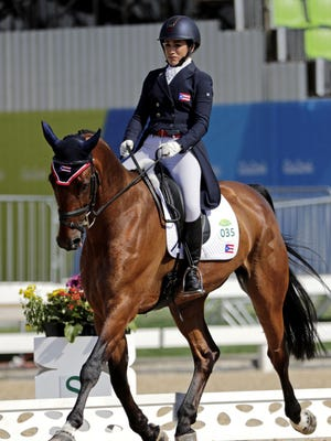 Redwood High School graduate Lauren Billys rides during the equestrian eventing dressage in the Rio 2016 Summer Olympic Games at Olympic Equestrian Center in Rio de Janeiro, Brazil. Check out today's edition of sports to see how the 27-year-old is faring at the games.