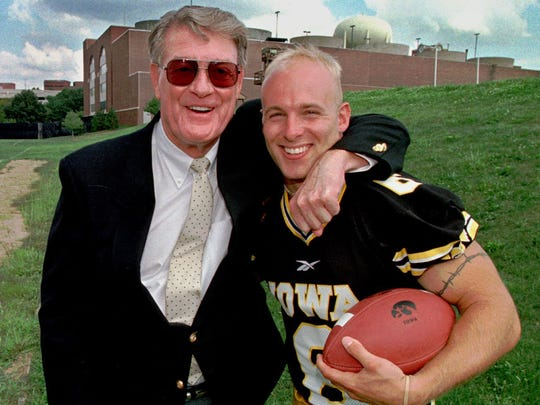 Tim Dwight (right), shown here in 1997 with Iowa coach Hayden Fry, was one of Iowa City High coach Larry Brown's stars.