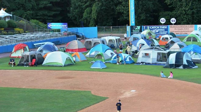 Scouts put up their tents at the Scout sleepover at Dutchess Stadium.