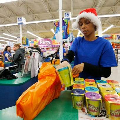 Cashier Kietta Dimery bags up a customer's purchases