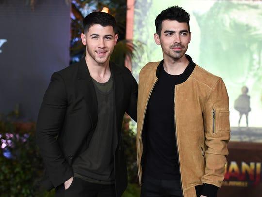 Nick Jonas and Joe Jonas arrive at the Los Angeles