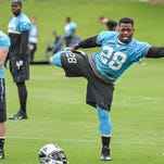Jonathan Stewart stretches during Thursday's practice at Panthers OTA's.