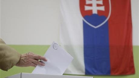 A woman casts her vote during general elections in Trnava, Slovakia, Saturday.