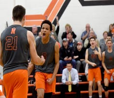 Northeastern players react during Tuesday's 3-2 win against York Suburban.