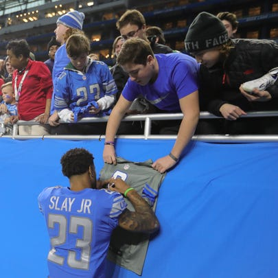 Darius Slay signs autographs for Lions fans as he leaves