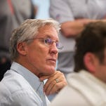 Seattle Seahawks oach Pete Carroll, left, and general manager John Schneider listen to questions from reporters Saturday, April 30, 2016, in Renton, Wash., after the end of the NFL football draft. (Lindsey Wasson/The Seattle Times via AP)