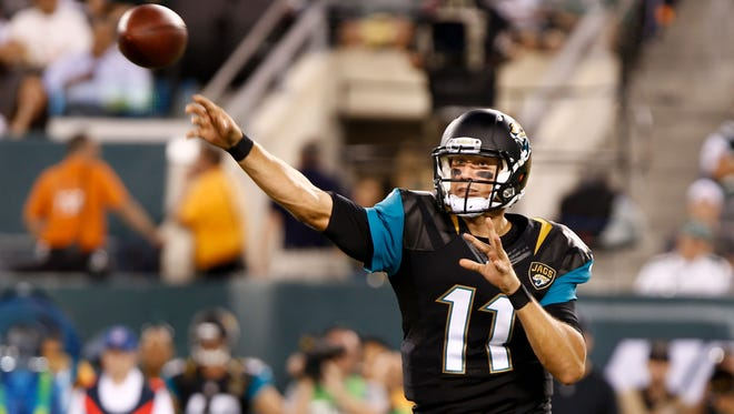 Jacksonville Jaguars quarterback Blaine Gabbert (11) throws a pass against the New York Jets during the first half at MetLife Stadium.