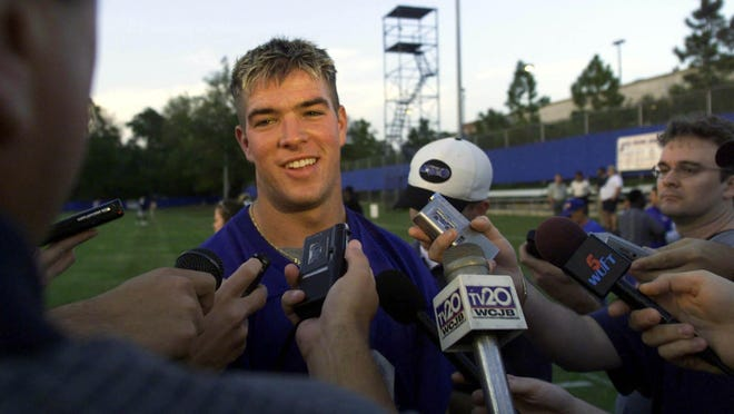 On the first day of spring football practice on March 14, 2000 at the University of Florida, freshman quarterback Brock Berlin worked out under the watchful eye of media and Gator fans.