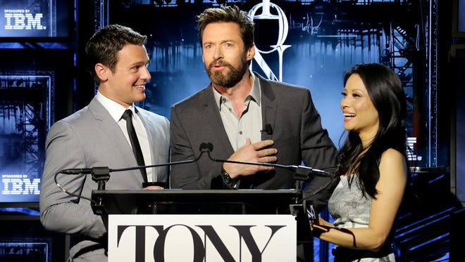 Hugh Jackman surprised Jonathan Groff and Lucy Liu as they were announcing the 2014 Tony nominations.