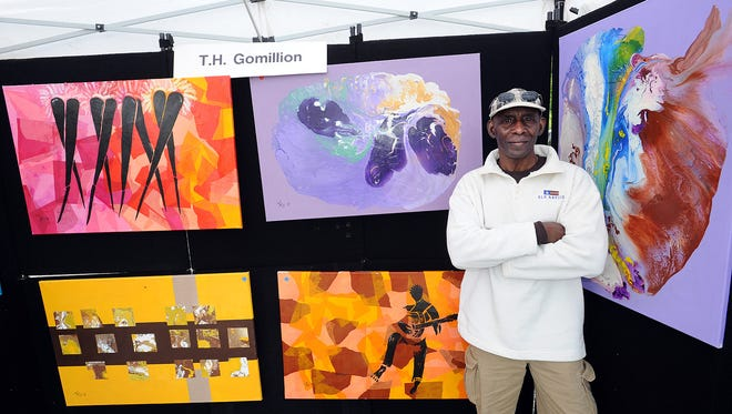 T.H. Gomillion from Washington, D.C. with his paintings at Dewey Beach's 2nd Annual Art Festival. The festival's fifth year kicks off May 7 at 9:30 a.m.