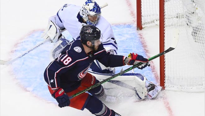 Pierre-Luc Dubois scores the winner in overtime, giving the Blue Jackets a 2-1 lead in a best-of-five series against Toronto.