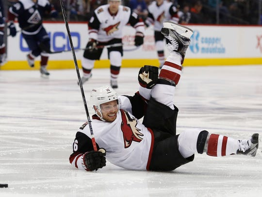 Arizona Coyotes center Max Domi falls to the ice driving