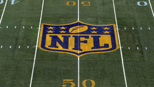 General view of the NFL gold shield logo at the 50-yard