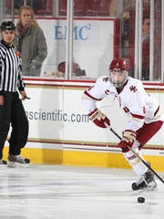Megan Keller moves the puck for the Boston College Eagles.