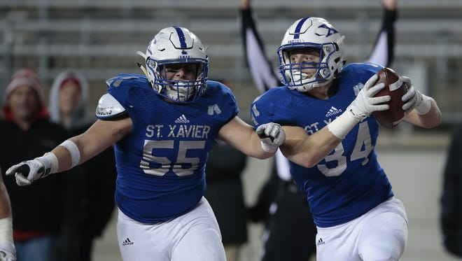 St. Xavier Blake Bacevich (34), right, reacts after recovering a fumble in the end zone for a touchdown in the fourth quarter during the OHSAA Division I state championship game between the Cincinnati St. Xavier Bombers and the Cleveland St. Ignatius Wildcats, Friday, Dec. 2, 2016, at Ohio Stadium in Columbus, Ohio.