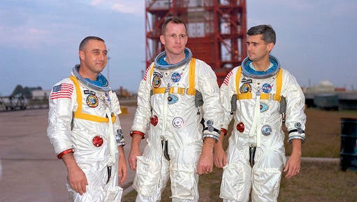 In this undated photo made available by NASA, from left, veteran astronaut Virgil Grissom, first American spacewalker Ed White and rookie Roger Chaffee, stand for a photograph in Cape Kennedy, Fla. During a launch pad test on Jan. 27, 1967, a flash fire erupted inside their capsule killing the three Apollo crew members.