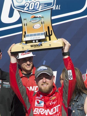Justin Allgaier celebrates winning the DC Solar 200 at Phoenix International Raceway on March 18, 2017 in Avondale, Ariz.