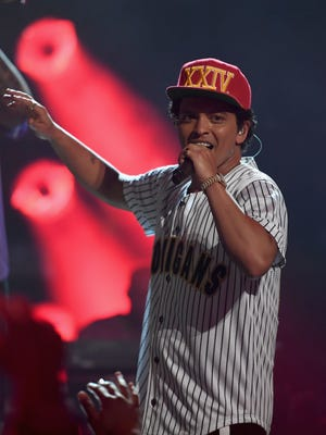 Bruno Mars is donating proceeds from a Michigan concert to those affected by the Flint water crisis.