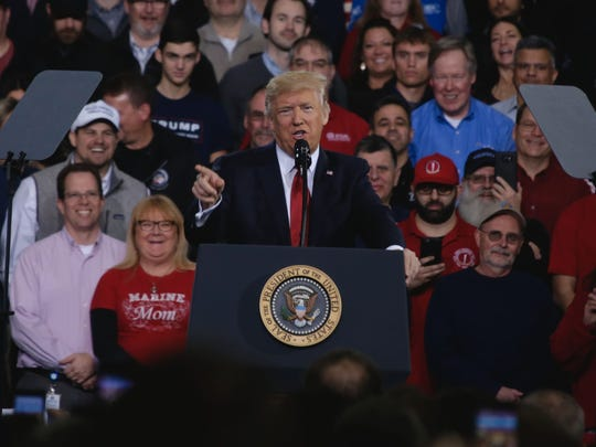 President Donald Trump speaks to a crowd at the American Center for Mobility in Ypsilanti Wednesday, March 15, 2017.