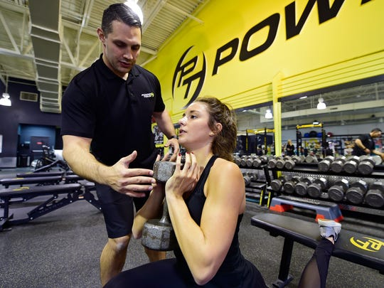 "Hannah Durbin, a senior at Elon University, works out at Power Train Mechanicsburg with Performance Director Evan Frey over her Thanksgiving Break. Durbin began battling anorexia in 2013, and says she's been fully recovered for a year and a half. She now uses her experience to inspire others through her ""Healthy Happy Hannah"" social media accounts and website."