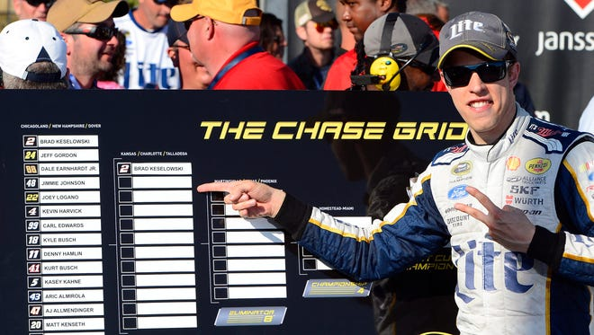 Brad Keselowski celebrates advancing to the second round of the Chase by winning the opener at Chicagoland Speedway.