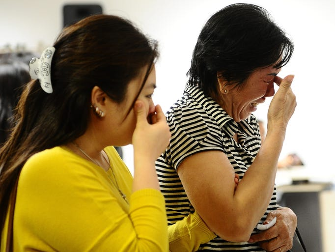 Relatives of missing passengers cry at the crisis center