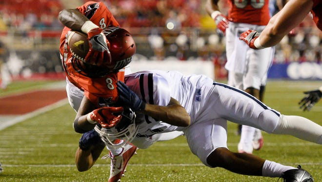 Jackson State defensive back Derrick Bobo attempts to tackle UNLV running back Charles Williams (left) as Williams dives for a touchdown. Coach Tony Hughes sees positives heading into Saturday's game against Tennessee State despite a 63-13 loss to UNLV.